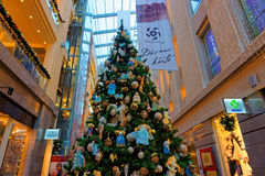 Traditional Christmas fir tree in multilevel shopping mall Stock Photos