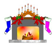 Traditional christmas fireplace. Fireplace at Christmas with hanging stockings Royalty Free Stock Photo