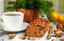 Traditional Christmas fruit cake with nuts, raisins, dried fruits and spices. Christmas treat Stock Photo