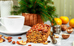 Traditional Christmas fruit cake with nuts, raisins, dried fruits and spices. Christmas treat Royalty Free Stock Images