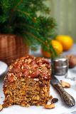 Traditional Christmas fruit cake with nuts, raisins, dried fruits and spices. Christmas treat Stock Photography