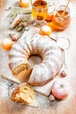 Traditional Christmas Fruit Cake pudding  on a Christmas decoration Royalty Free Stock Photography