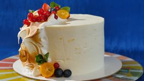 Traditional Christmas fruit cake with white frosting and sugared fruits. Cream cake with kumquat, cranberries. Strawberries stock photography