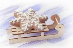 Traditional christmas gingerbread cookie on little wooden sled Royalty Free Stock Photos