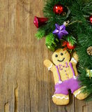 Traditional Christmas gingerbread man with festive decorations Stock Photography