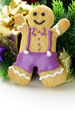 Traditional Christmas gingerbread man with festive decorations Royalty Free Stock Images