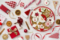 Traditional christmas gingerbread, toys and decor on wooden background royalty free stock photography