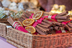 Traditional christmas market decoration, basket full of whole cinnamon Royalty Free Stock Photos