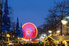 Traditional christmas market with illuminated ferris wheel in th Stock Photo
