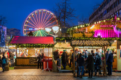 Traditional christmas market with illuminated ferris wheel in th Royalty Free Stock Photography