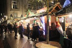 Traditional Christmas Market in Luxembourg. Ville. Crowd of people having fun in the evening. Kids, adults, families, old and young , all together celebrating Stock Photos