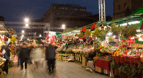 Traditional Christmas market near Cathedral in night Stock Photo