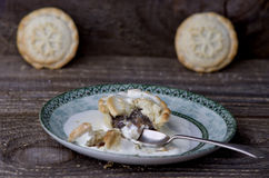 Traditional Christmas mince pies on old rustic wooden table Stock Images