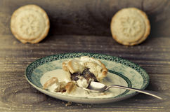 Traditional Christmas mince pies on plate, wooden table. Royalty Free Stock Photography