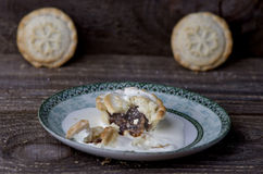 Traditional Christmas mince pies on wooden table. Stock Image