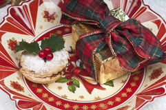Traditional Christmas mincepie and gift. Royalty Free Stock Image