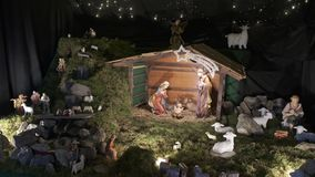 Traditional Christmas nativity scene, Holy family with baby Jesus in crib, Biblical gospel concept