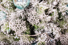 Traditional christmas or new year decorated tree with a silver snowflake toy Stock Photography