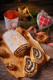 Traditional christmas poppy seed cake on wooden table Royalty Free Stock Photos