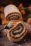Traditional christmas poppy seed cake on wooden table Royalty Free Stock Photography