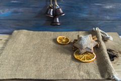 Traditional Christmas spiced cookie. Traditional Christmas spiced star shaped cookie, two slices of dried orange and a stick of cinnamon Royalty Free Stock Photo