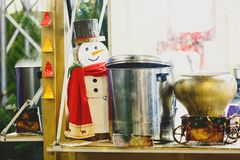 Traditional christmas stall at new year and christmas market with lights, decorations, vats with hot teas, mulled wine royalty free stock image