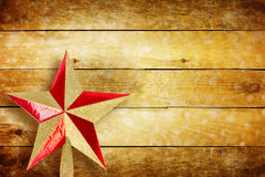 Traditional Christmas star on wooden wall Royalty Free Stock Photos