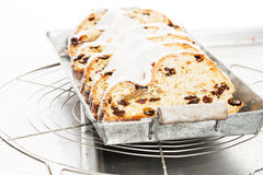 Traditional christmas stollen cake on a metal tray Royalty Free Stock Photography
