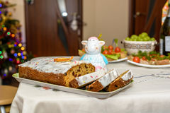 Traditional Christmas table with cake, fruits and canapes Stock Photography