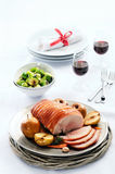 Traditional christmas table setting with pork roast Royalty Free Stock Photo