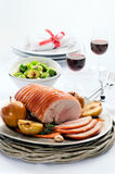 Traditional christmas table setting with pork roast Royalty Free Stock Image
