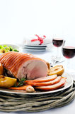 Traditional christmas table setting with pork roast Royalty Free Stock Photos