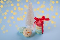 Traditional christmas themed french macaroons sweets in the form of snowman, snowflake, christmas tree and santa`s belly with can Stock Photos