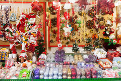 Traditional Christmas toys and gifts at stand Royalty Free Stock Photos
