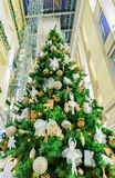 Traditional Christmas tree at Galerija Centrs in old Riga. Riga, Latvia - December 26, 2015: Decorated fir Christmas tree at the shopping center in old Riga Stock Photography