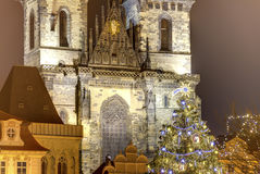Traditional Christmas tree at Old towns square in Prague, Czech republic, with the church of Mother of God before Tyn behind it Royalty Free Stock Photography
