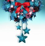 Traditional Christmas wreath with bow and stars. royalty free stock photography
