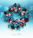 Traditional Christmas wreath on winter background. Stock Images