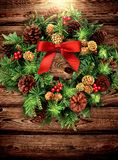Traditional Christmas wreath on wooden background. stock photo