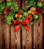 Traditional Christmas wreath on wooden background. royalty free stock photo