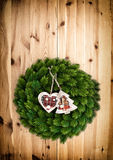 Traditional christmas wreath on wooden background Royalty Free Stock Photography