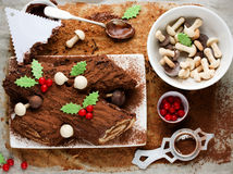 Traditional Christmas Yule Log cake decorated with chocolate hol Royalty Free Stock Photos