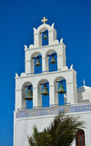Traditional church with bells on Santorini, Greece. Stock Images