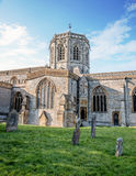 Traditional  Church Building. Medieval, Grave Yard & Blue Sky. Royalty Free Stock Photos