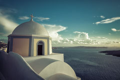 Traditional church on the cliff in Thira, Santorini Island Stock Photo