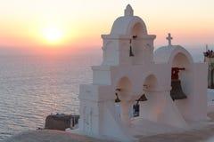 Traditional church in Cyclades style. OIA / GREECE - AUGUST 2014: Traditional church in Cyclades style during sunset, Oia village, Santorini island, Greece Stock Photos