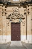 Door architecture detail in mdina old town of rabat malta. Traditional church door architecture detail in mdina old town of rabat malta Stock Photo