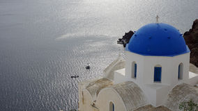 Traditional church in small village oia on santorini Stock Image