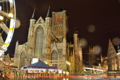 Traditional churches and  buildings on a rainy night, winter festival scene Royalty Free Stock Photos