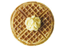 Traditional classic belgium american waffle with butter and maple syrup. Close up of traditional classic belgium american waffle with butter and maple syrup stock photo